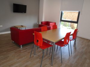Table and Chairs in Petros Court social space