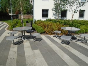 Picnic benches in Petros Court court yard