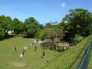 people playing football in the Dane John Gardens